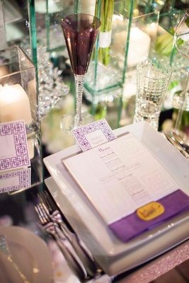 Purple cross on menu card with mirror wedding table