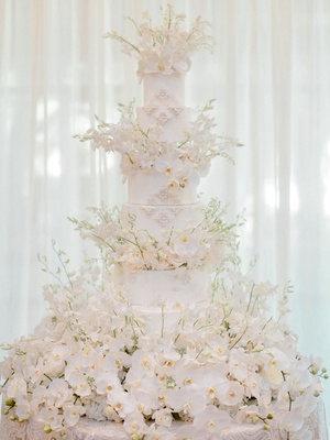 Wedding cake with orchids and pearl beading from bride's dress beautiful masterpiece ivory white