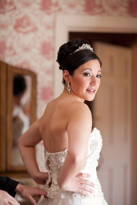 Bride in a strapless Monique Lhuillier gown and tiara