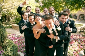 Fun portrait of groom and wedding party