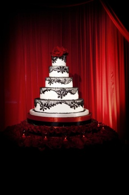 Five layer cake with black lace and roses