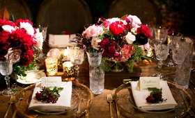 Reception with wood table, clear charger plate gold rim, flower at place setting, crystal goblets