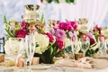 Wedding reception centerpieces ivory flowers pink peonies roses and candles rose gold beige linens
