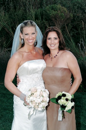 Bride and bridesmaid with wedding flowers