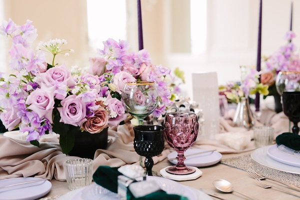 wedding inspiration styled shoot, colored goblets, dark green, maroon, lavender flowers