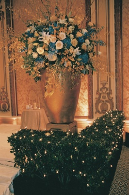 huge gold vase of blue, white and gold flowers