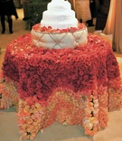 White kosher cake on table covered with roses