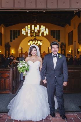 Bride and groom ecstatic as they leave church ceremony