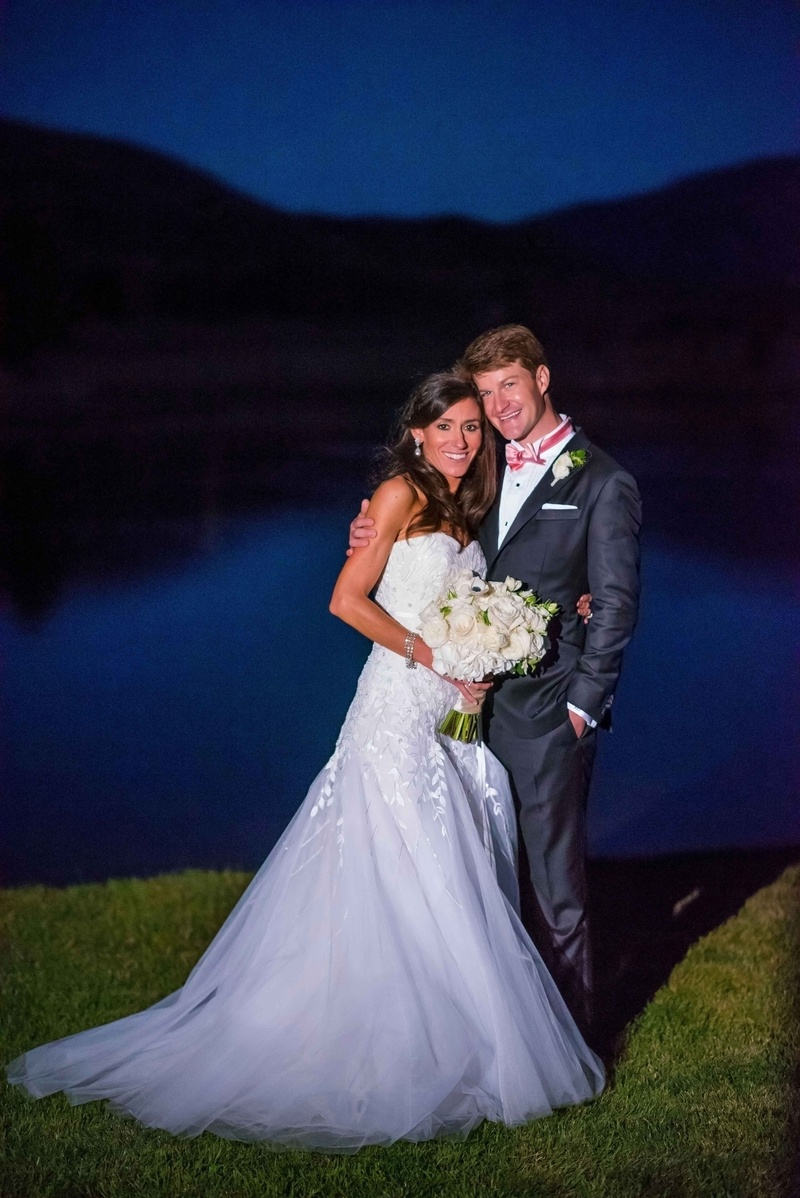 Bride in strapless Carolina Herrera gown with embroidery and tulle skirt groom in pink bow tie