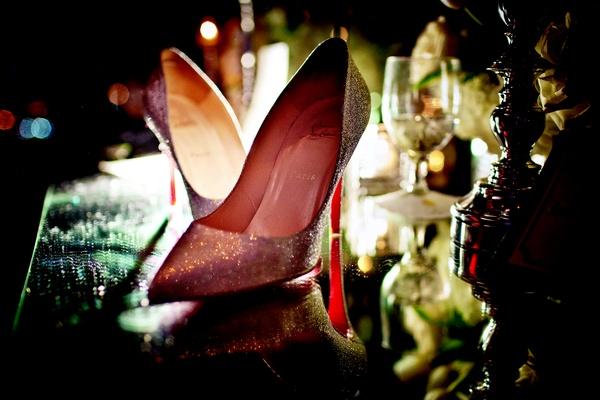 Glitter Christian Louboutin heels on mirror table