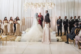 wedding ceremony white flooring gold chairs lucite acrylic arch arbor with white rose orchid flowers