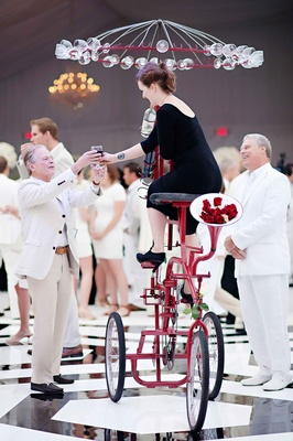 Tall red tricycle wedding wine server at reception