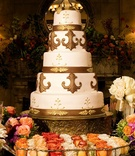 Gold fleur de lis wedding cake with gold cake topper
