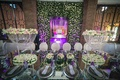long mirror top table high centerpieces floral wall purple uplighting morocco destination wedding