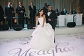 Bride in Vera Wang wedding dress and groom dance on custom dance floor to sounds of Brian McKnight