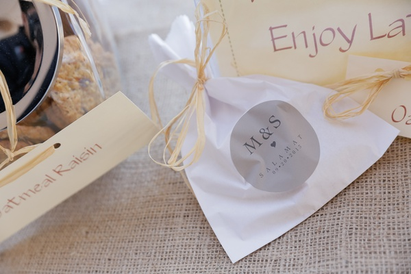White take-home bags with custom grey wedding sticker