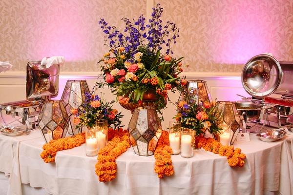 geometric mercury lanterns, vibrant florals in vase, marigold, sangeet indian reception