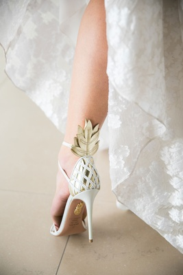 Bride with funky wedding heels pineapple gold ankle detail with criss cross heel embellishments