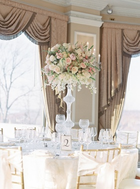 wedding reception gold chairs with ribbon bow back calligraphy table number in frame crystal candles