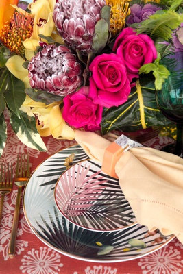 wedding reception styled shoot inspiration tropical palm frond print plates gold flatware pink rose