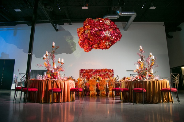 fire inspired wedding styled shoot, floral arrangements in orange, red, yellow, foil installation