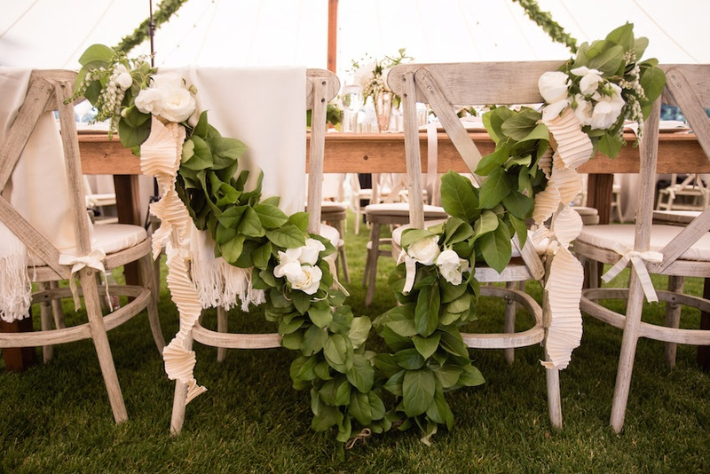 Newlyweds chair decorations with garland and ribbon