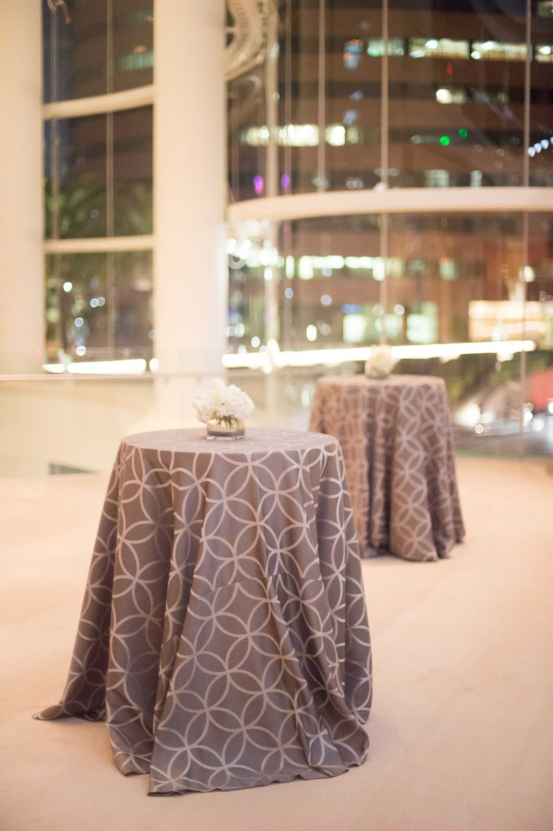 Small round tables topped with two-tone linen