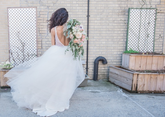 back of bride in pantora bridal wedding dress, backless bridal gown with tulle skirt