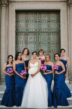 Bride with African American bridesmaids in royal blue dressses