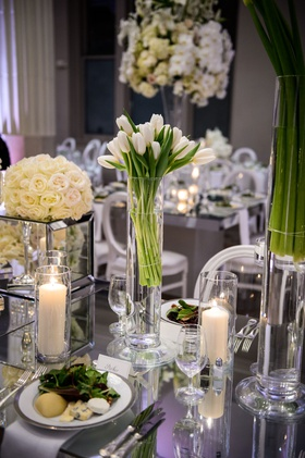 wedding reception table salad course dinner candles white tulips in vase white rose flowers