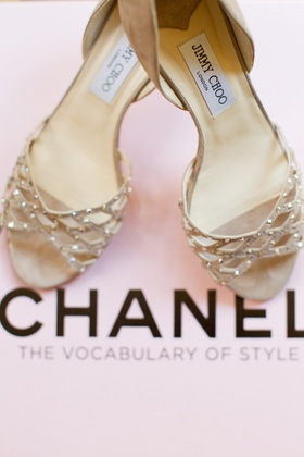 Bride's light brown, suede Jimmy Choo pumps with golden stones
