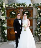 bride in a line gown classic look updo veil white bouquet groom in tuxedo church ceremony wedding