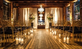 carondelet house wedding ceremony hardwood floors wood ceilings candles black and gold