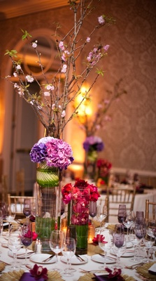 Purple Champagne glasses and towering centerpieces