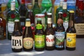 Bottles of different beers and ales at outdoor wedding reception