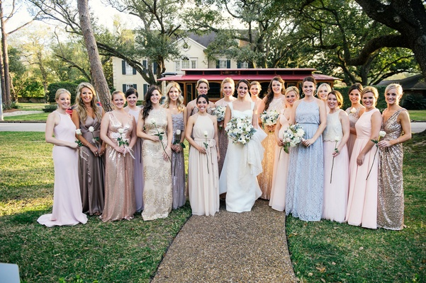 Bridesmaids and honor attendants in mismatched wedding dresses blush, blue, silver, peach, lavender