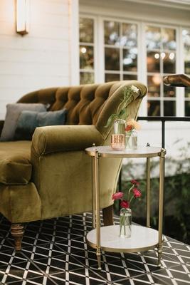 wedding reception lounge furniture black white tile gold side table olive green vintage sofa tufted
