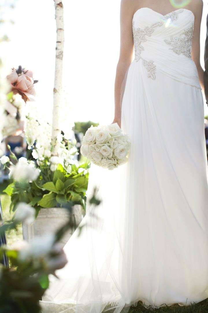 Marchesa bridal gown and white bouquet