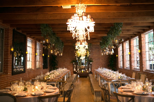 Brittany Daniel and Adam Touni wedding reception carondelet house blubell events chandeliers wood