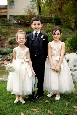 Boy in three-piece tuxedo and girls in dresses
