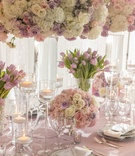Wedding reception inspiration lavender linen floating candles silver candle votives white purple