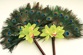 Stick of green and blue feathers with orchid