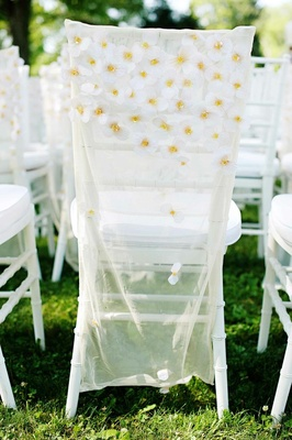 White chiavari chairs with sheer daisy covers