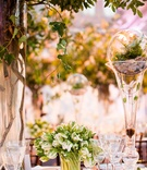 Wedding table decorations with rocks, leaves, branches