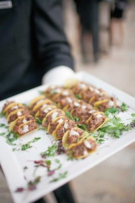 Wedding appetizer with mini shaved pork tacos