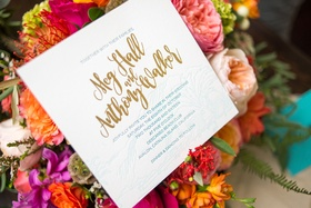 invitations in gold blue and white with calligraphy