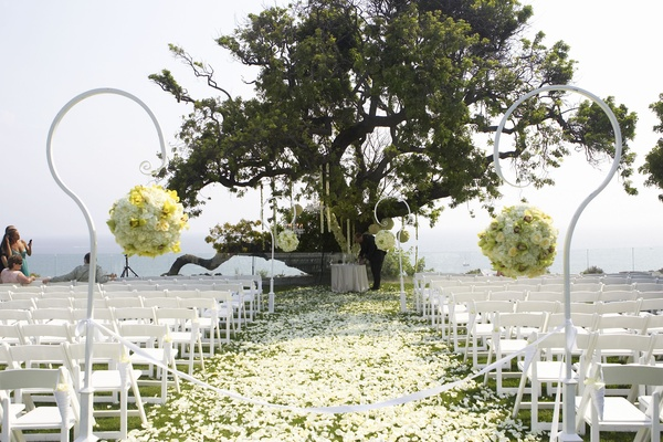 Outdoor ceremony with flower petal aisle