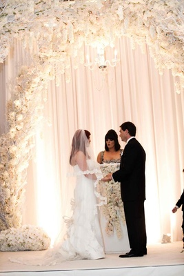 Bride and groom at altar with female officiant