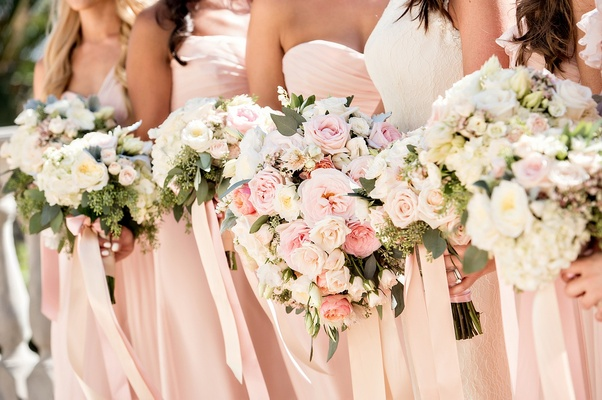 pastel hued bouquets bride bridesmaids pink foliage ribbons california wedding