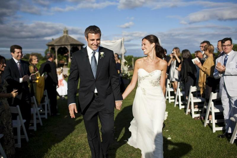 Couple walking away from birch chuppah